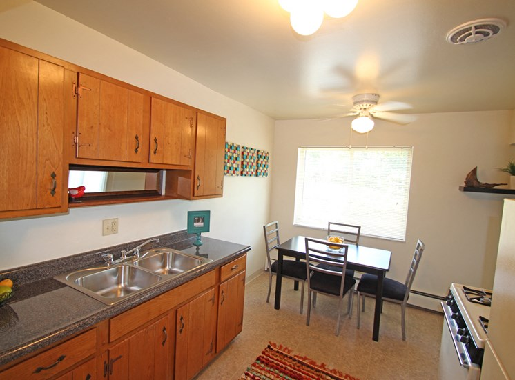 This is a photo of the kitchen of the 2 bedroom model apartment at Blue Grass Manor Apartments in Erlanger, KY