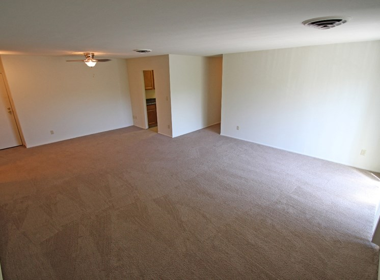 This is a photo of the living room in a 1371 square foot 4 bedroom apartment at Park Lane Apartments in Cincinnati, OH.