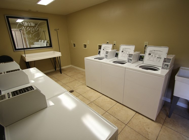 This is a photo of the clothes care center at Trails of Saddlebrook Apartments in Florence, KY.