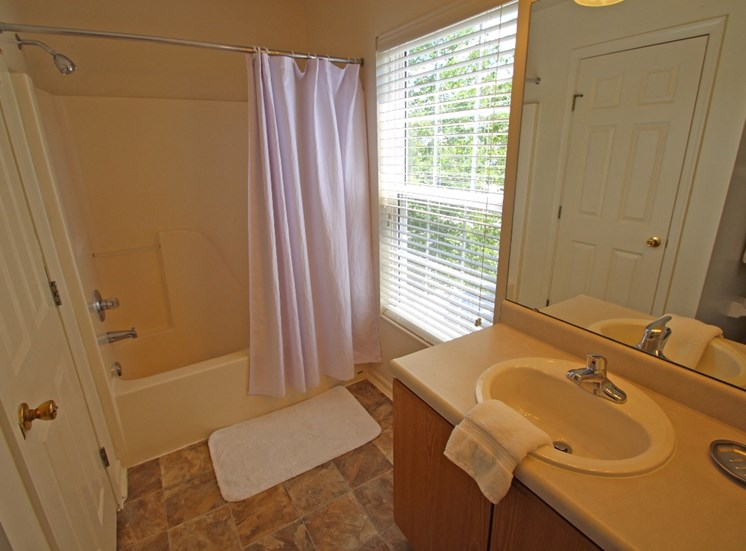 This is photo of the bathroom of the 852 square foot 1 bedroom Fairlawn at Trails of Saddlebrook Apartments in Florence, KY.