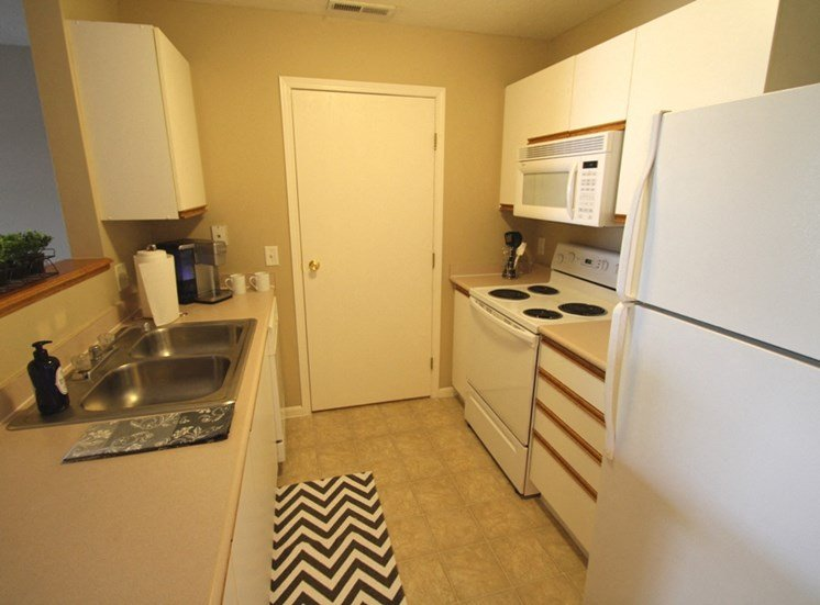 This is a photo of the kitchen in the 1110 square foot Freedom Patio at Washington Place Apartments in Washington Township, OH.