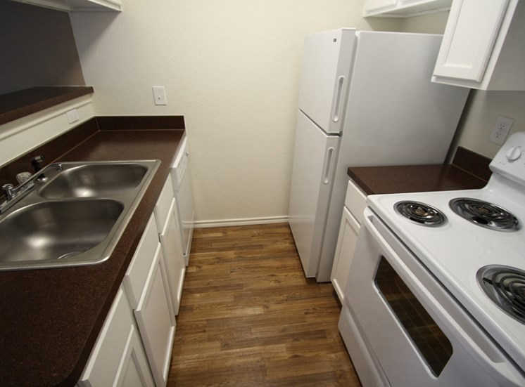 This is a photo of the kitchen of the 717 square foot 1 bedroom loft apartment at Canyon Creek Apartments in Dallas, TX