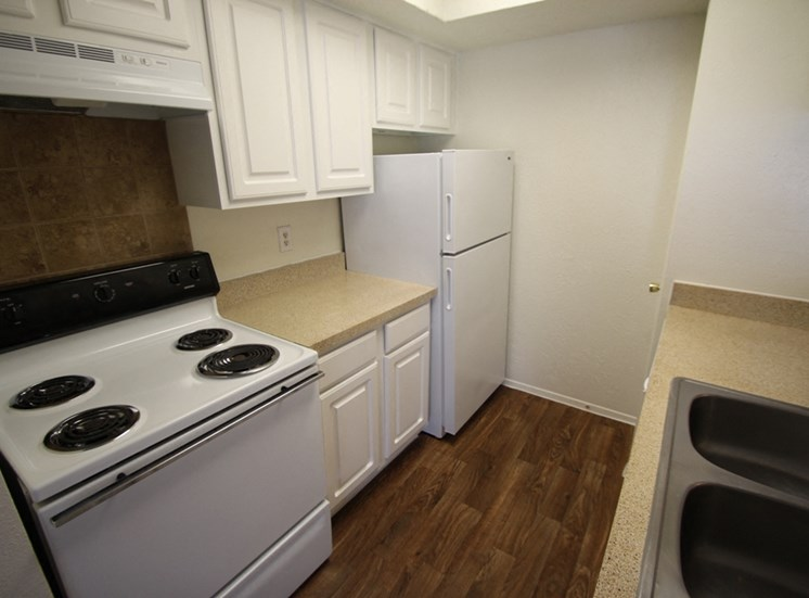 This is a photo of the kitchen of the 550 square foot 1 bedroom apartment at Canyon Creek Apartments in Dallas, TX