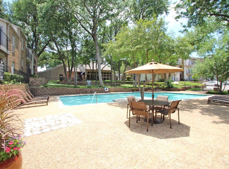 This is a photo of the pool area at Canyon Creek Apartments in Dallas, TX