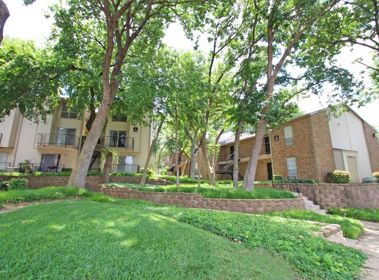 This is a photo of the grounds/ building exteriors at Canyon Creek Apartments in Dallas, TX