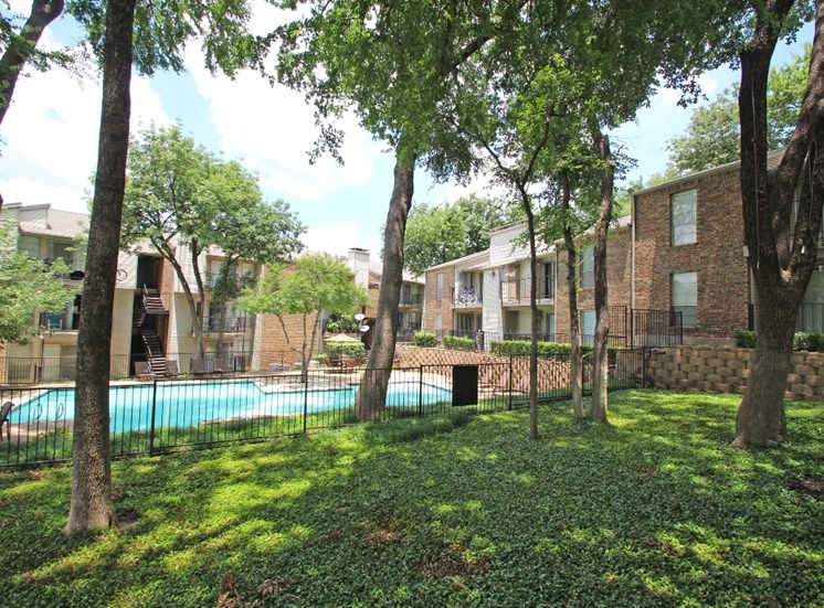 This is a photo of the grounds/pool area at Canyon Creek Apartments in Dallas, TX