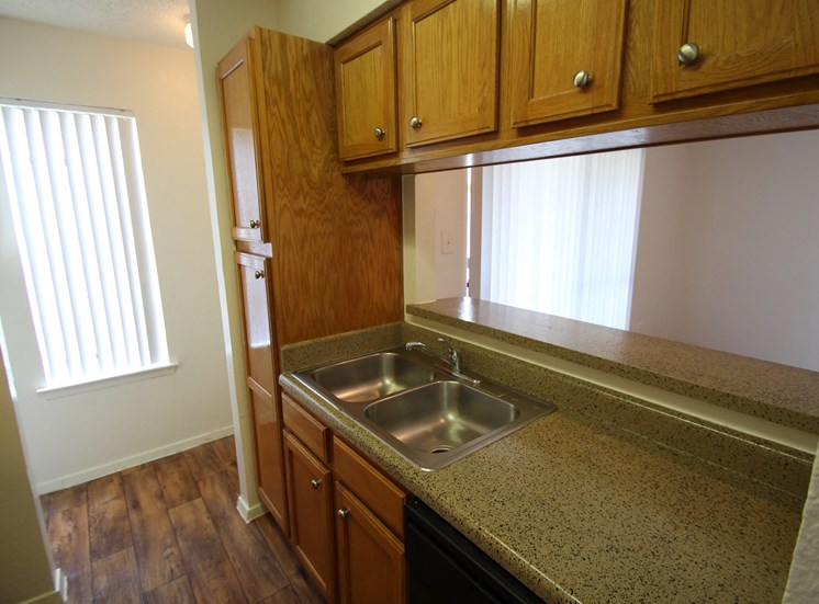 This is a picture of a kitchen in the 870 square foot 2 bedroom apartment at Gateway Place Apartments in Garland, TX.