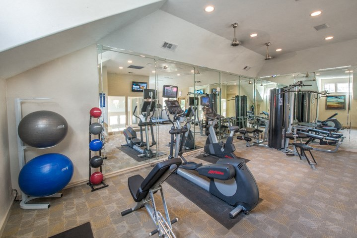 This is a photo of the 24-hour fitness center at The Brownstones Townhome Apartments in Dallas, TX.