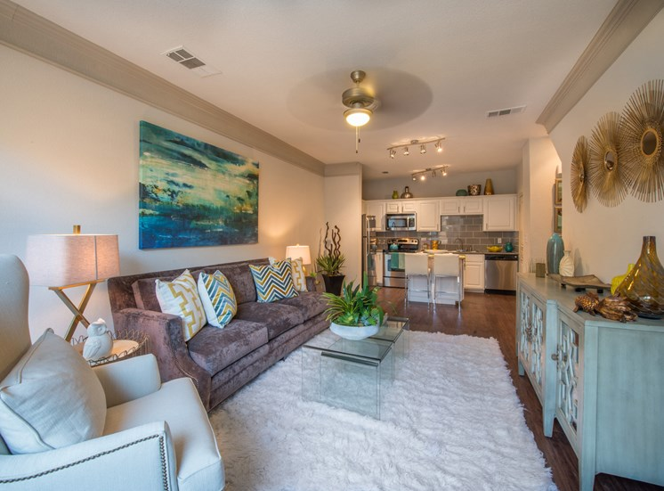 This is a photo of the living room of the 826 square foot 1 bedroom  apartment at The Brownstones Townhome Apartments in Dallas, TX.