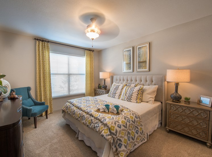 This is a photo of the bedroom of the 826 square foot 1 bedroom  apartment at The Brownstones Townhome Apartments in Dallas, TX.