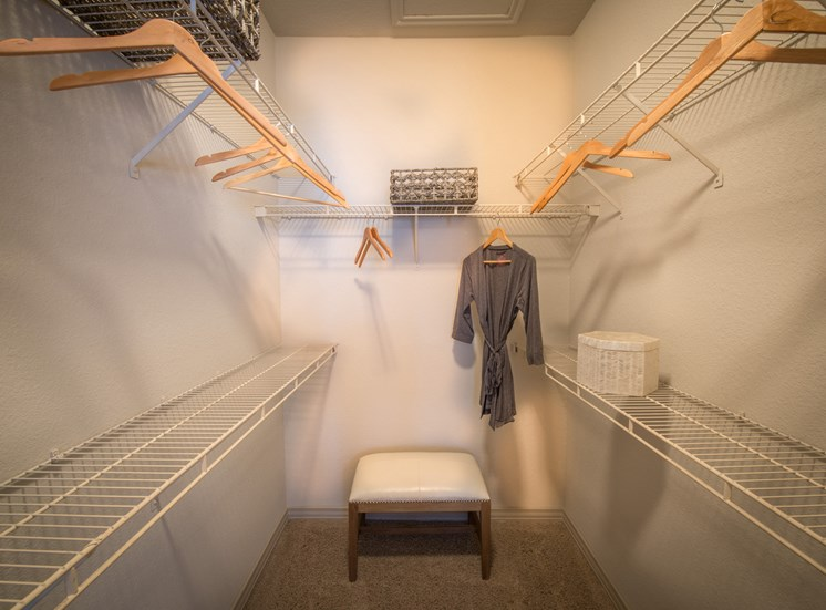This is a photo of the walk-in closet of the 826 square foot 1 bedroom  apartment at The Brownstones Townhome Apartments in Dallas, TX.