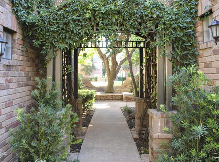 This is a photo of a courtyard at The Brownstones Townhome Apartments in Dallas, TX.