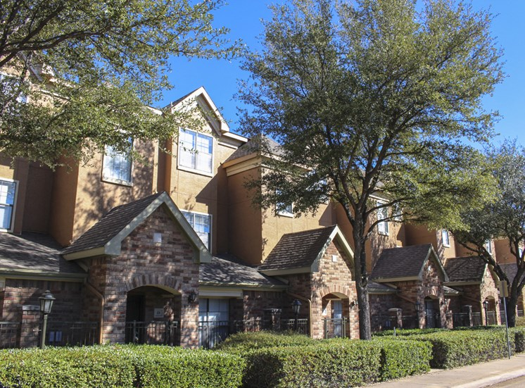 This is a photo of some Townhome exteriors at The Brownstones Townhome Apartments in Dallas, TX.
