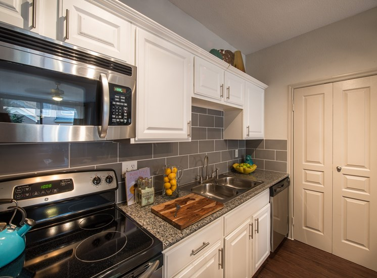 This is a photo of the kitchen of the 826 square foot 1 bedroom  apartment at The Brownstones Townhome Apartments in Dallas, TX.