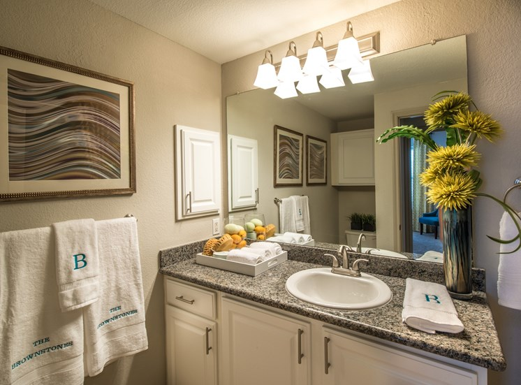 This is a photo of the bathroom of the 826 square foot 1 bedroom  apartment at The Brownstones Townhome Apartments in Dallas, TX.