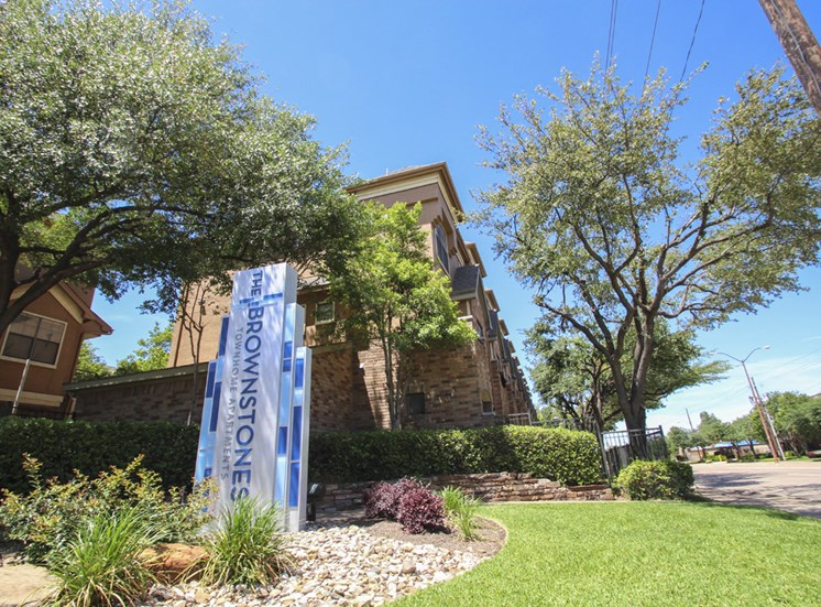 This is a photo of the monument sign/grounds at The Brownstones Townhome Apartments in Dallas, TX.