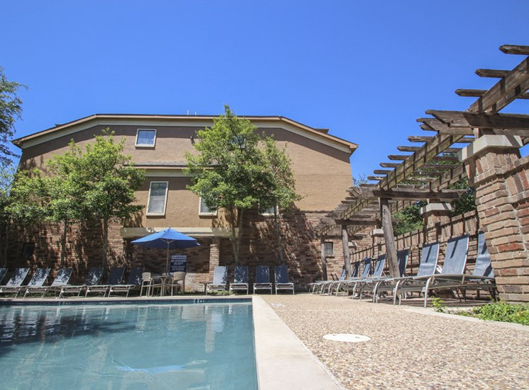 This is a photo of the pool area at The Brownstones Townhome Apartments in Dallas, TX.