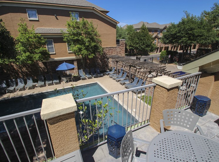 This is a photo of the sundeck/pool area at The Brownstones Townhome Apartments in Dallas, TX.