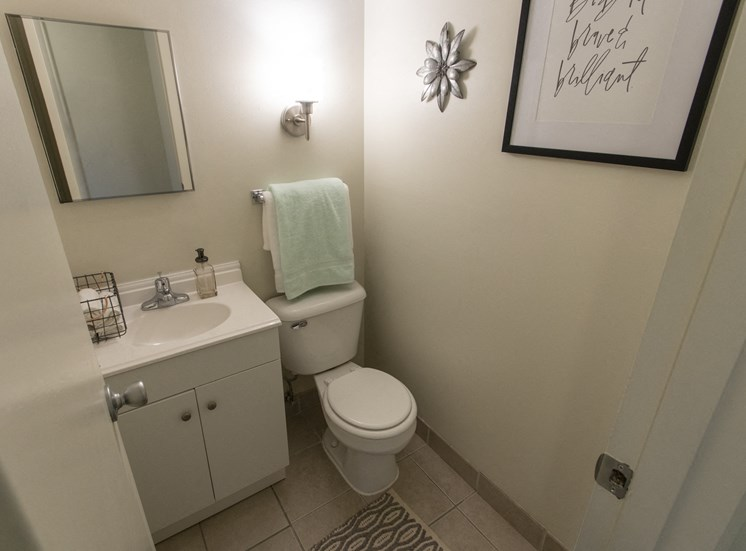 This is a photo of the bathroom in the 740 square foot 1 bedroom model apartment at Compton Lake Apartments in Mt. Healthy, OH.