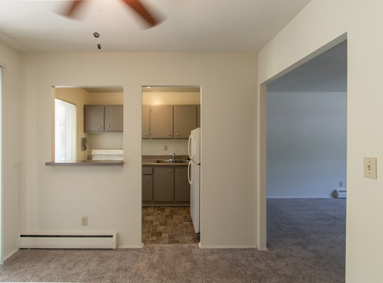 This is a photo looking into the kitchen from the dining room of the 631 square foot, B-style 1 bedroom floor plan at Colonial Ridge Apartments in Cincinnati, OH.