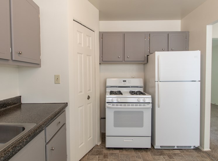 This is a photo of the kitchen in the 1004 square foot, 2 bedroom townhome floor plan at Colonial Ridge Apartments in Cincinnati, OH.