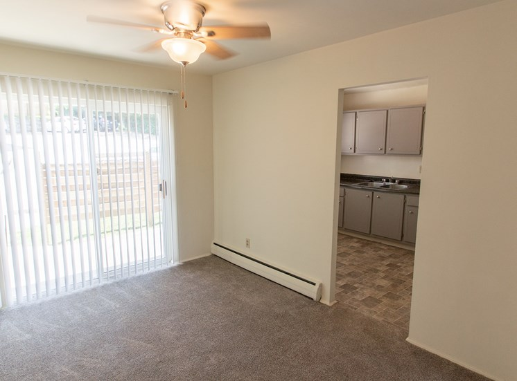 This is a photo of the dining room in the 1004 square foot, 2 bedroom townhome floor plan at Colonial Ridge Apartments in Cincinnati, OH.