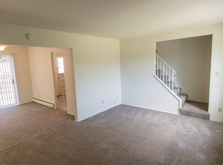 This is a photo of the living room in the 1004 square foot, 2 bedroom townhome floor plan at Colonial Ridge Apartments in Cincinnati, OH.