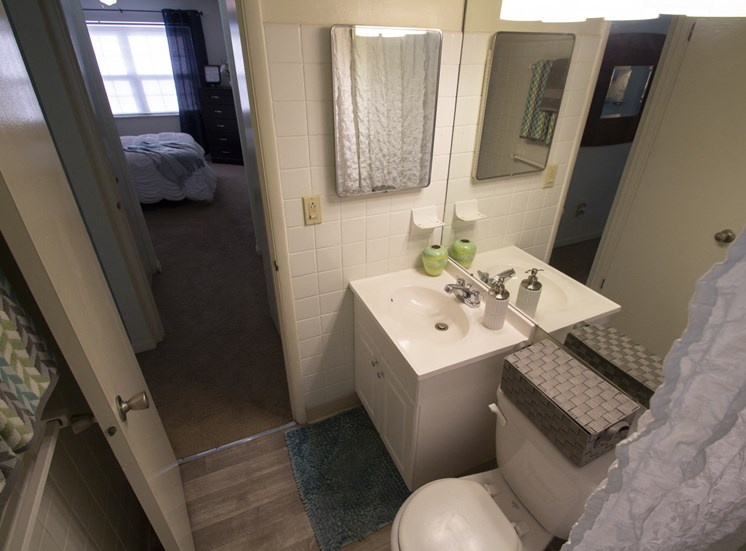 This is a photo of the bathroom of the 550 square foot 1 bedroom, balcony floor plan model apartment at College Woods Apartments in Cincinnati, OH.