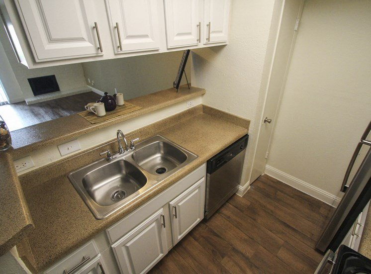 This is a photo of the kitchen of the 880 square foot 2 bedroom apartment at Canyon Creek Apartments in Dallas, TX