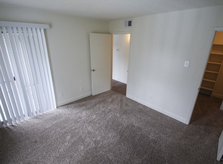 This is a photo of the second bedroom of the 880 square foot 2 bedroom apartment at Canyon Creek Apartments in Dallas, TX