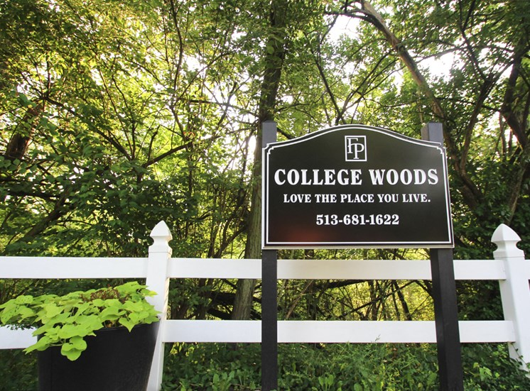 This is a photo of the entrance sign at College Woods Apartments in Cincinnati, OH.