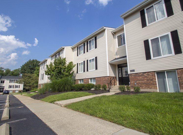 This is a picture looking down a row of apartment entrances at Deer Hill Apartments in Cincinnati, Ohio.