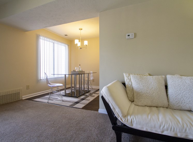 This is a photo looking into the dining room from the living room in a 1 bedroom apartment at Deer Hill Apartments in Cincinnati, OH.