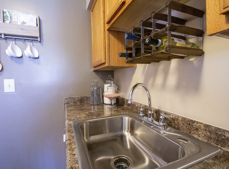 This is a closeup photo of the sink area in the kitchen of a 2 bedroom apartment at Deer Hill Apartments in Cincinnati, OH.