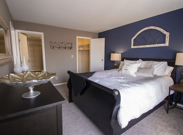 This is a photo of the master bedroom of a 2 bedroom apartment at Deer Hill Apartments in Cincinnati, OH.