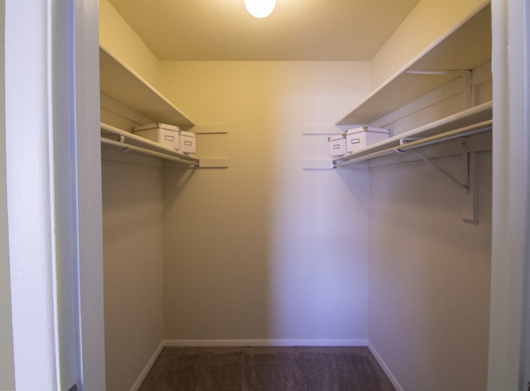 This is a photo of the walk in closet in the master bedroom of a 2 bedroom apartment at Deer Hill Apartments in Cincinnati, OH.