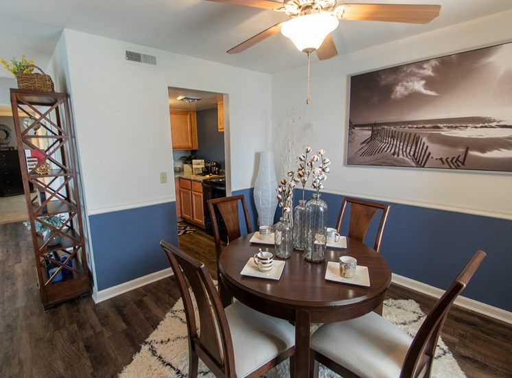 This is a picture of the dining room in an upgraded 980 square foot, 2 bedroom model apartment at Fairfield Pointe Apartments in Fairfield, Ohio.