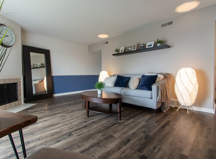This is a picture of the living room in an upgraded 980 square foot, 2 bedroom model apartment at Fairfield Pointe Apartments in Fairfield, Ohio.