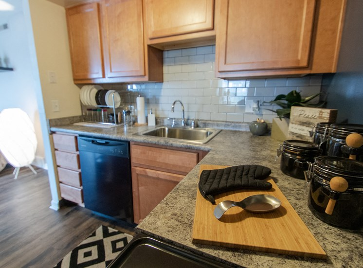 This is a picture of the kitchen in an upgraded 980 square foot, 2 bedroom model apartment at Fairfield Pointe Apartments in Fairfield, Ohio.