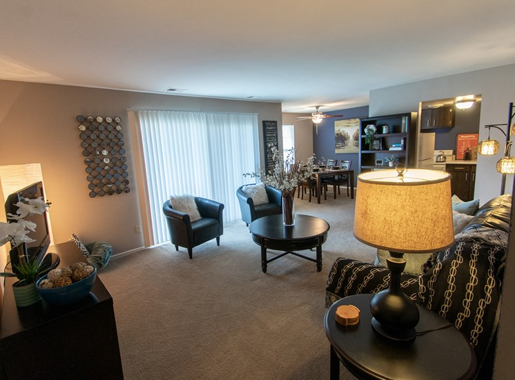 This is a picture of the living room in the 980 square foot, 2 bedroom model apartment at Fairfield Pointe Apartments in Fairfield, Ohio.