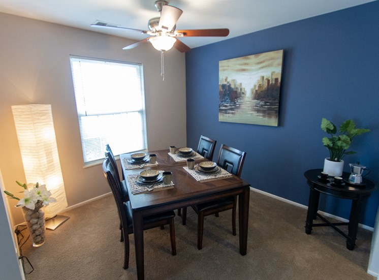 This is a picture of the dining room in the 980 square foot, 2 bedroom model apartment at Fairfield Pointe Apartments in Fairfield, Ohio.