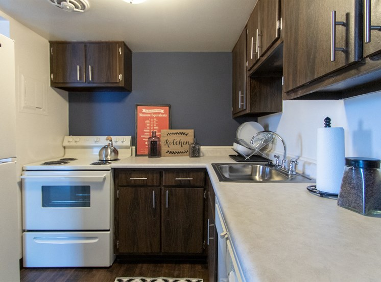 This is a picture of the kitchen in the 980 square foot, 2 bedroom model apartment at Fairfield Pointe Apartments in Fairfield, Ohio.