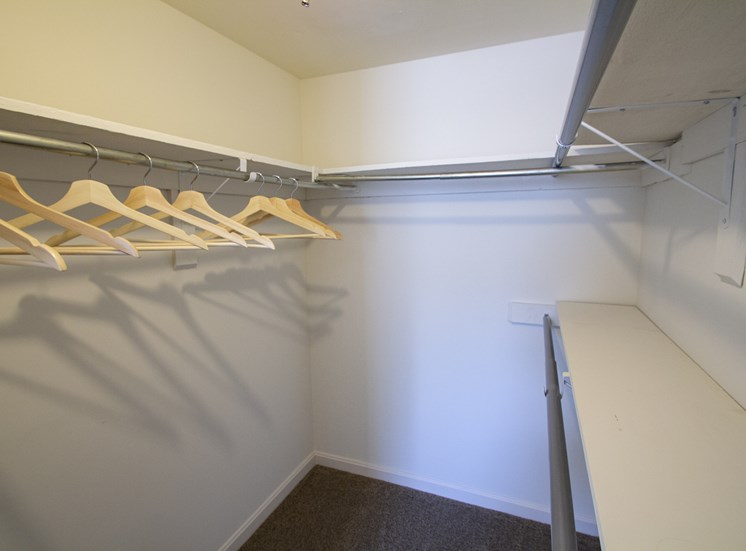 This is a picture of the master bedroom walk-in closet of the 980 square foot 2 bedroom apartment at Fairfield Pointe Apartments in Fairfield, Ohio