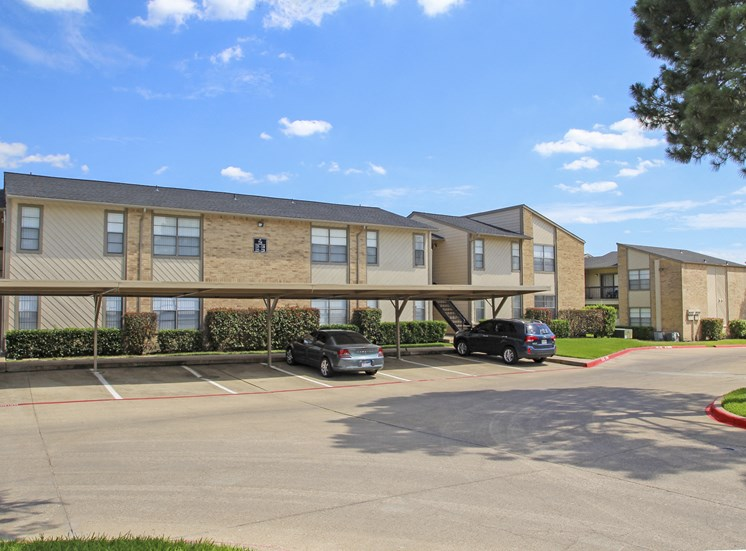 This is a picture of a building and carport at Gateway Place Apartments in Garland, TX.