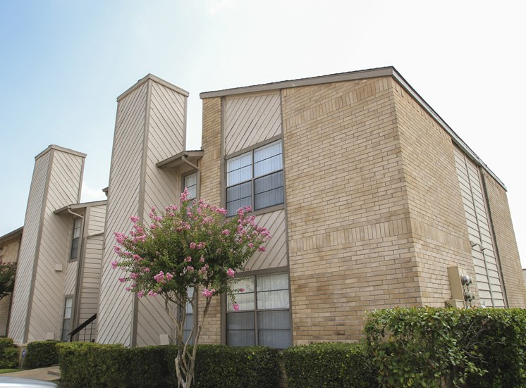 This is a picture of a building exterior at Gateway Place Apartments in Garland, TX.