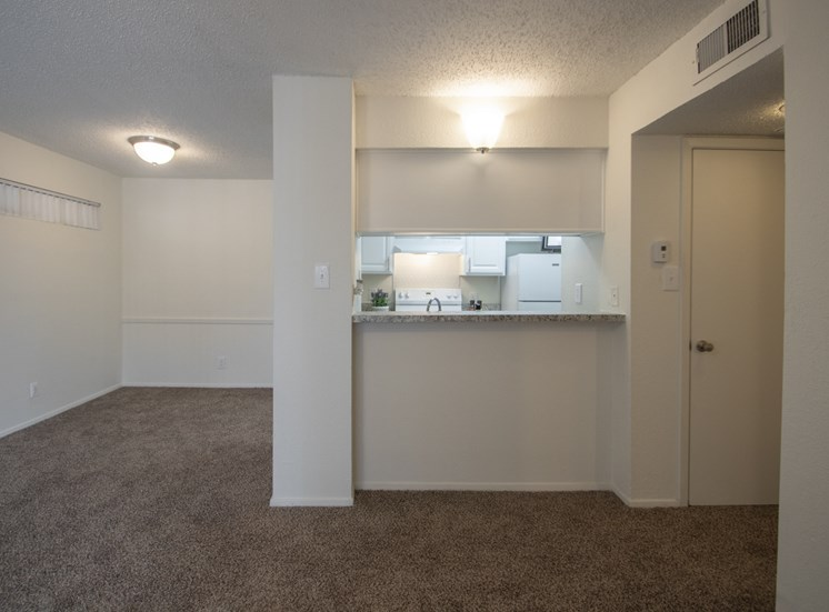 This is a photo of the dining area and breakfast bar in the 690 square foot 1 bedroom apartment at Gateway Place Apartments in Garland, TX.