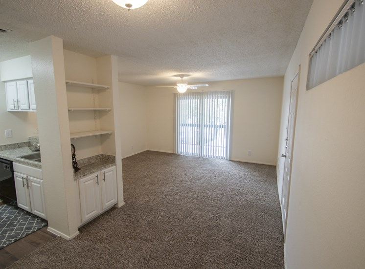 This is a photo of the dining area and living rooms in the 690 square foot 1 bedroom apartment at Gateway Place Apartments in Garland, TX.