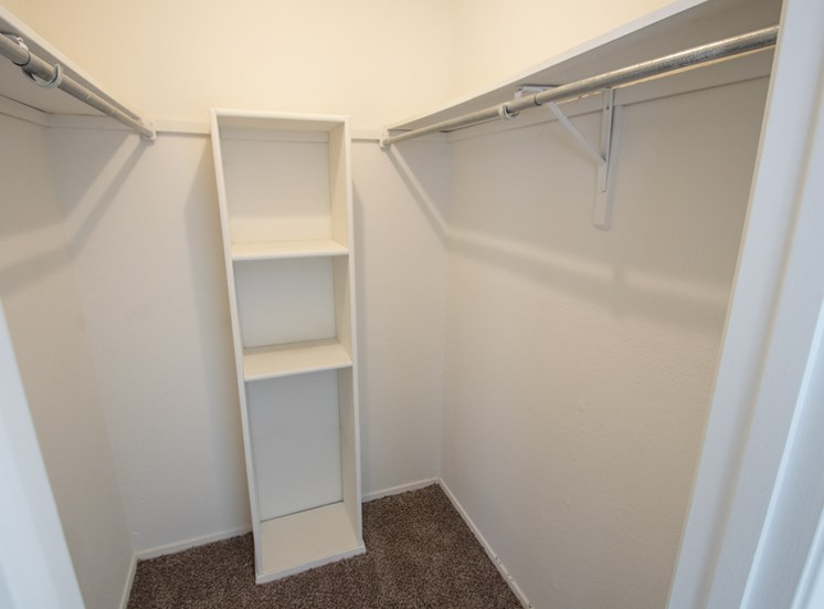 This is a photo of the second bedroom walk-in closet in the 915 square foot 2 bedroom apartment at Gateway Place Apartments in Garland, TX.