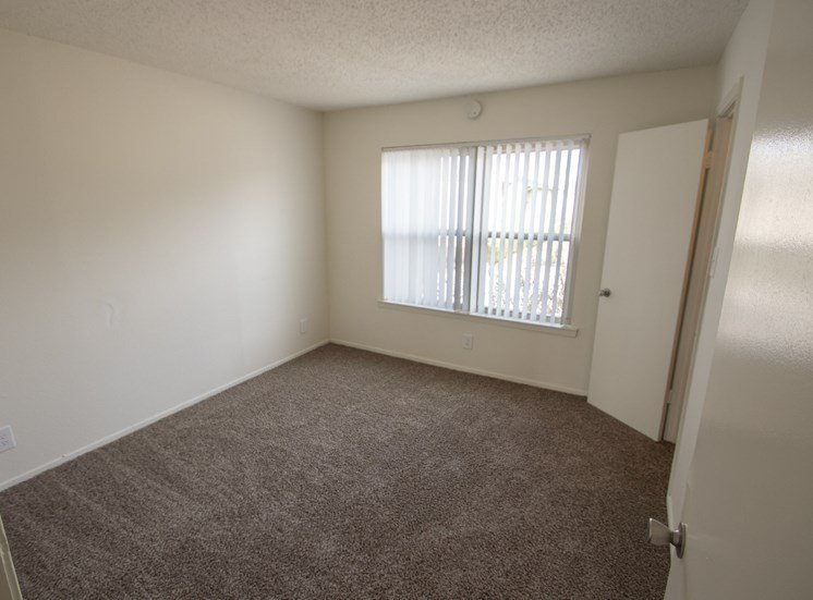 This is a photo of the second bedroom in the 915 square foot 2 bedroom apartment at Gateway Place Apartments in Garland, TX.