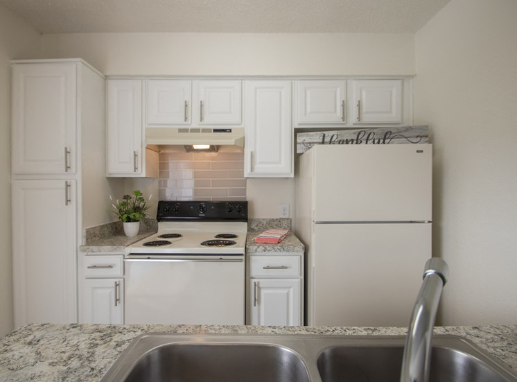 This is a photo of the kitchen in the 915 square foot 2 bedroom apartment at Gateway Place Apartments in Garland, TX.